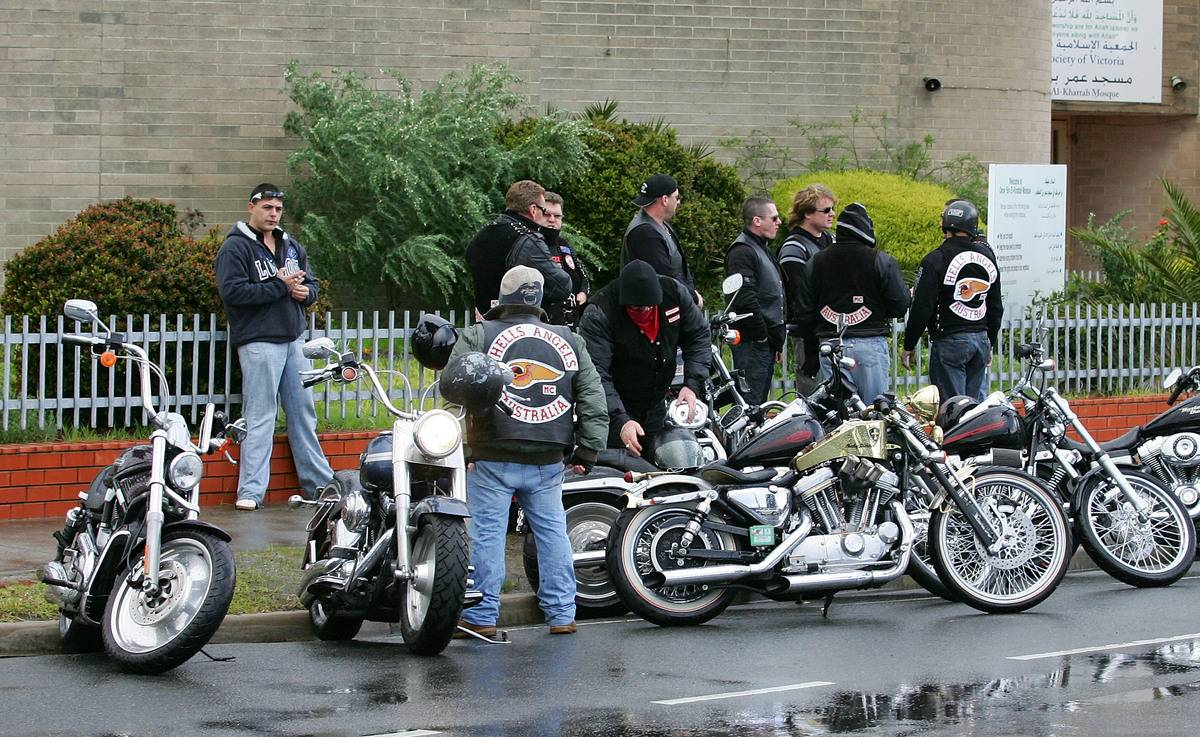 Hells Angels members are parked on the side of the road.