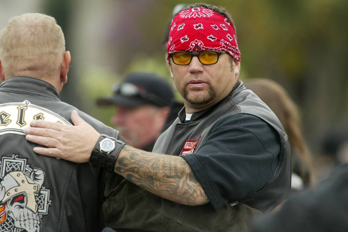 A Hells Angels member pats another member on the back.