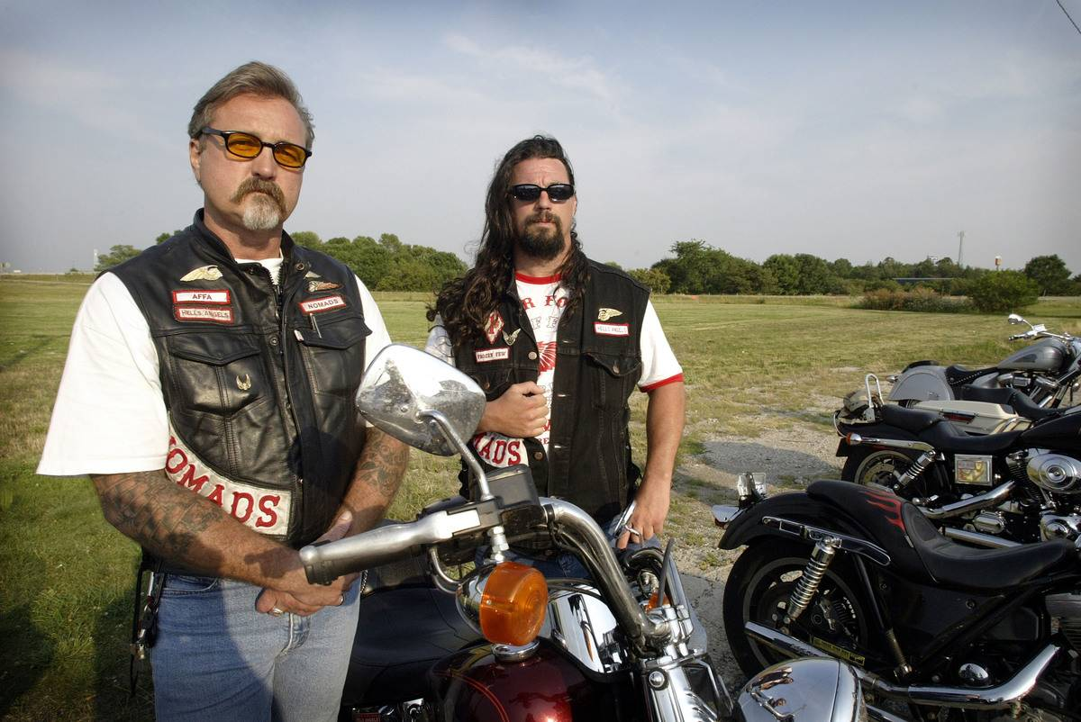 Two members of Hells Angels stare at the camera.