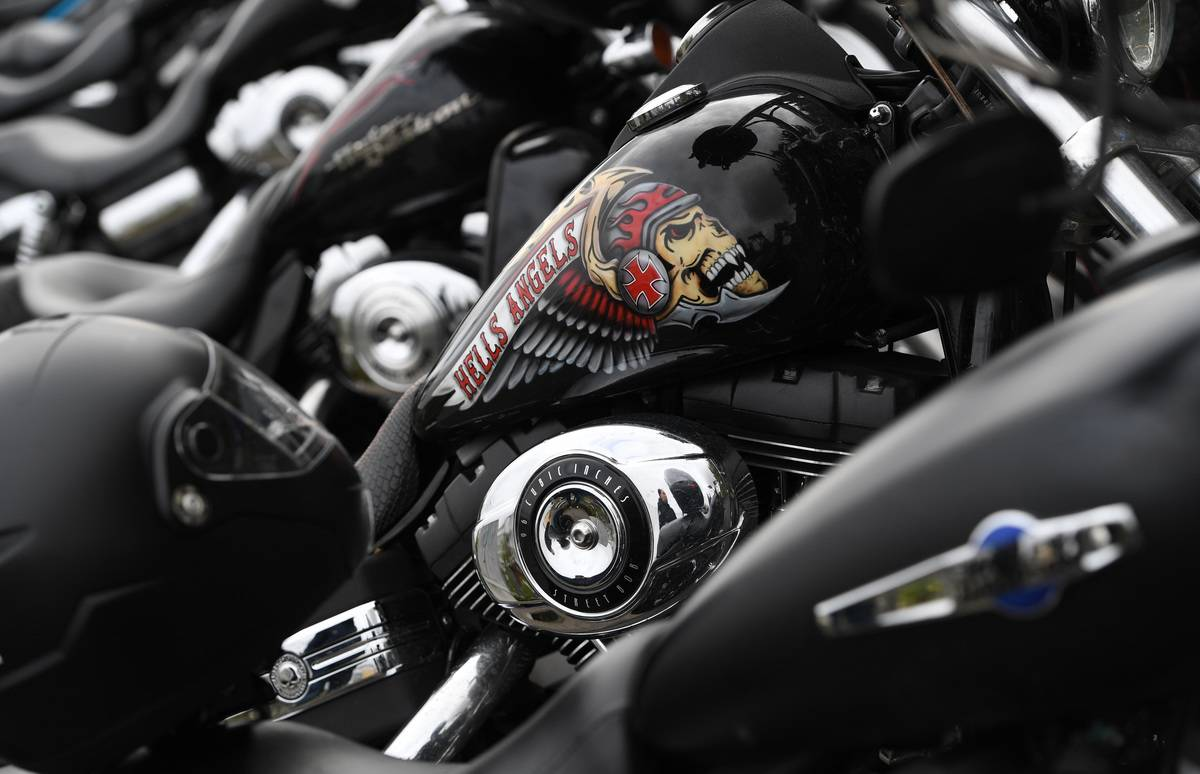 The Hells Angel symbol is on the tank of a motobike.