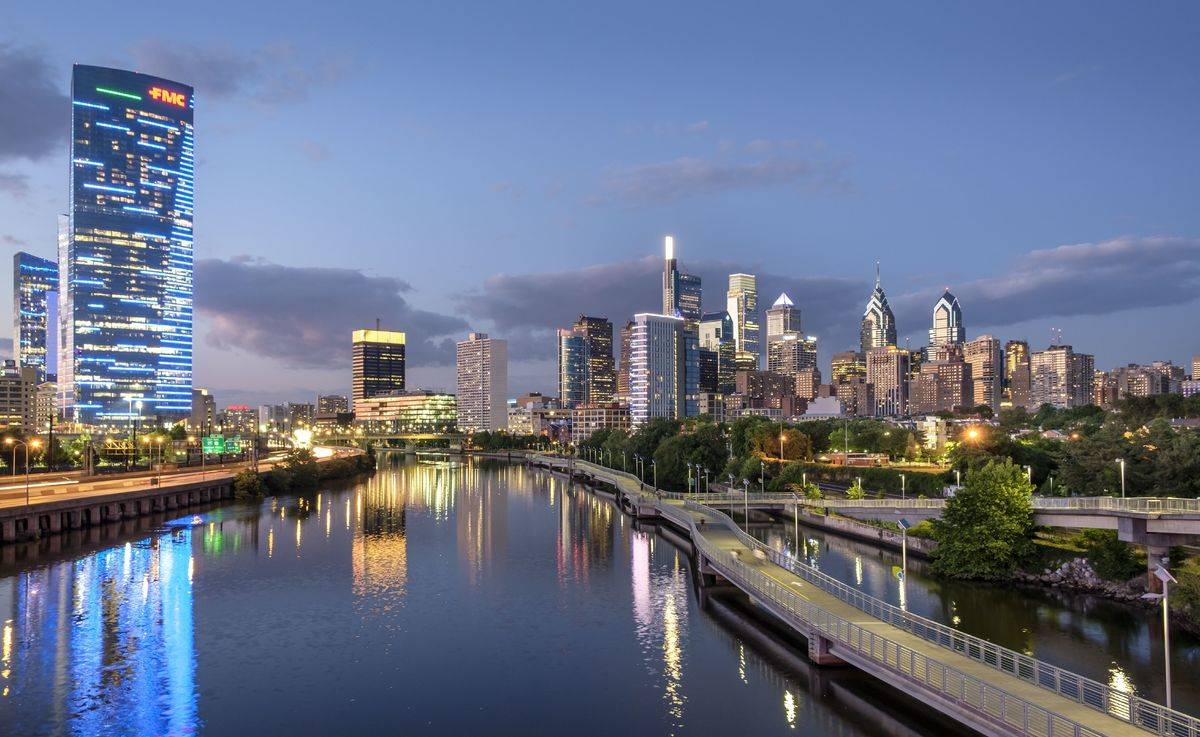 Philadelphia Skyline and Highway 76 with Schuylkill River Park Boardwalk in summer at night, Philadelphia, Pennsylvania