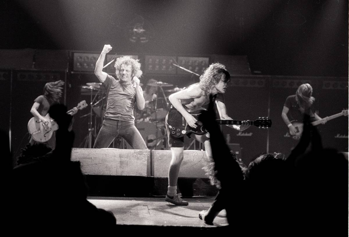 AC/DC performs live onstage in 1980.