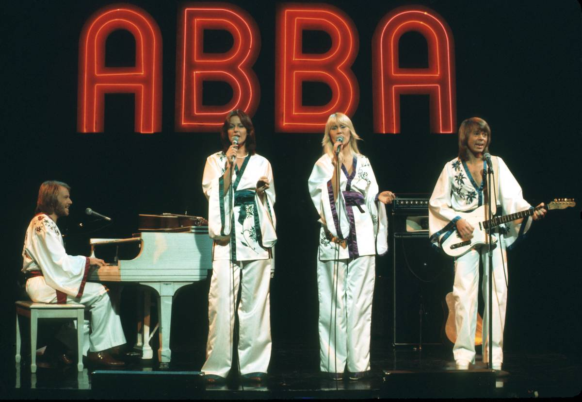 The music group ABBA plays onstage during a midnight special, 1976.