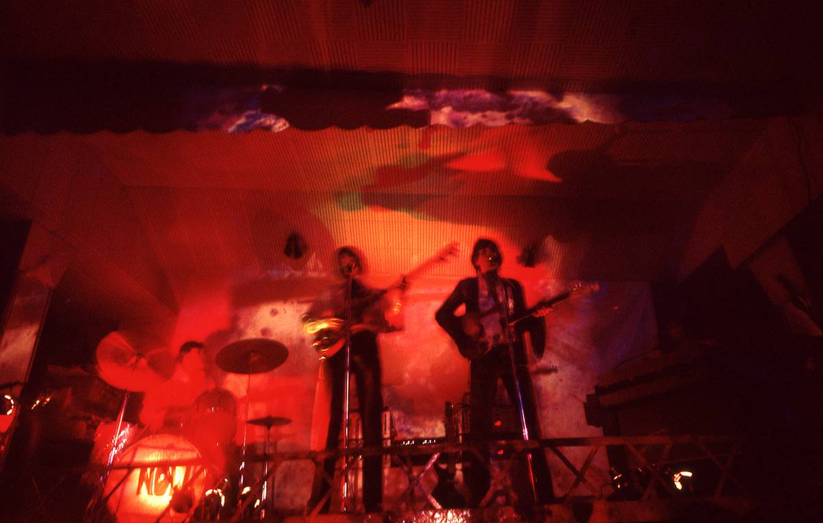 Pink Floyd performs underneath a psychedelic light show in 1966.
