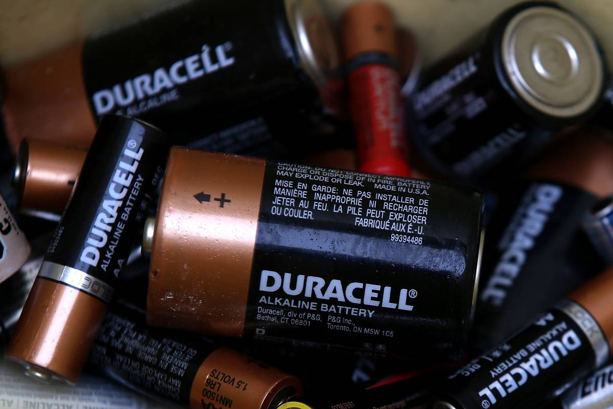 Several Duracell batteries lie on top of each other.