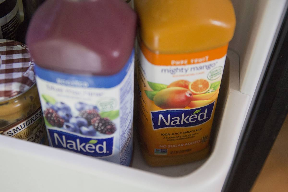 Naked Juice bottles are arranged in a box.