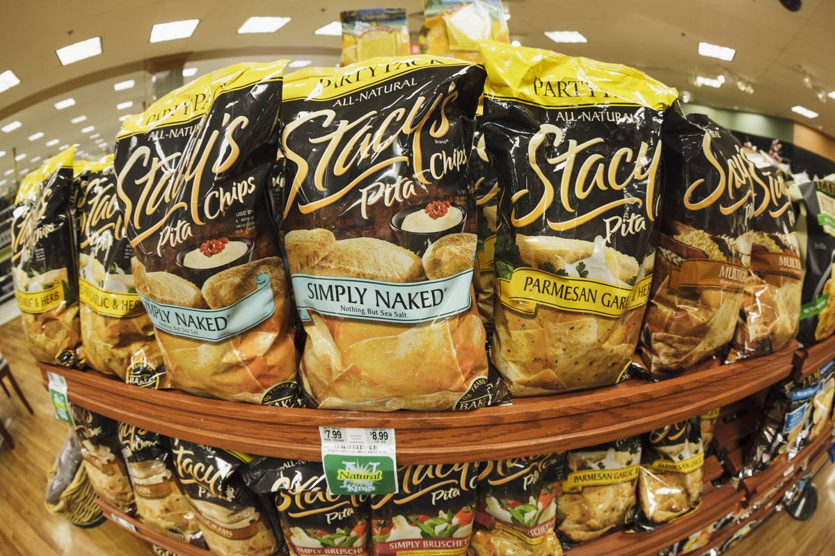 Large bags of Stacy's Pita Chips line a shelf at a Kings Food Market.