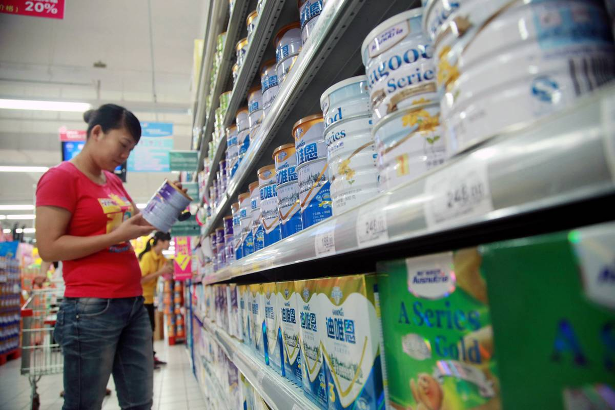 A shopper examines some Abbott baby formula at a supermarket.