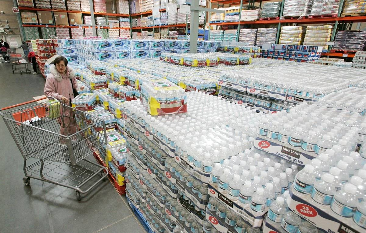 A customer shops for bottled water at Costco.