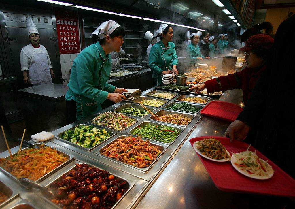 Customers pick food during a buffet dinner