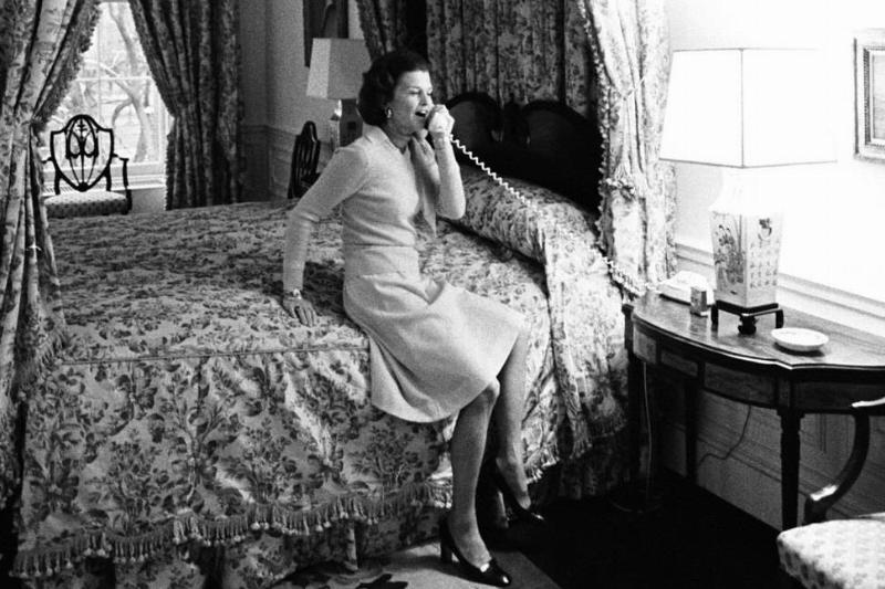 First Lady Betty Ford takes a phone call in the second floor Queen's bedroom.