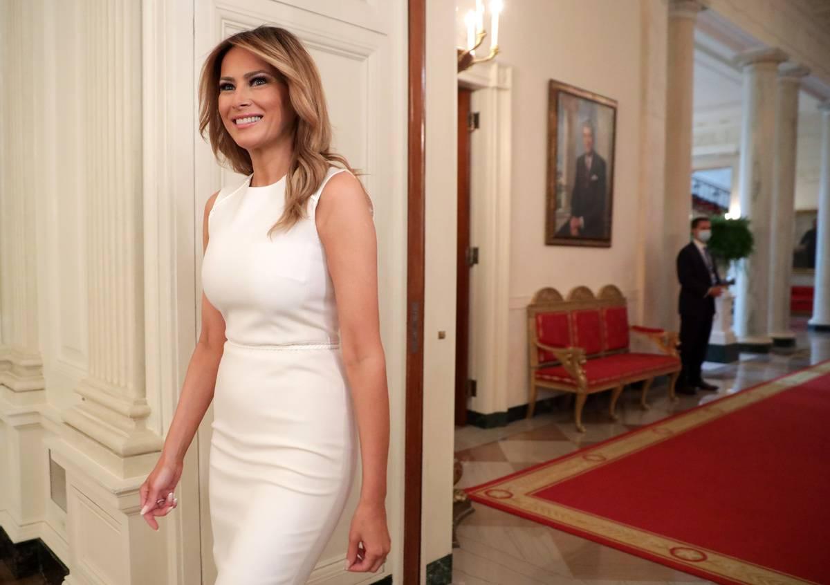 First Lady Melania Trump walks through the White House.