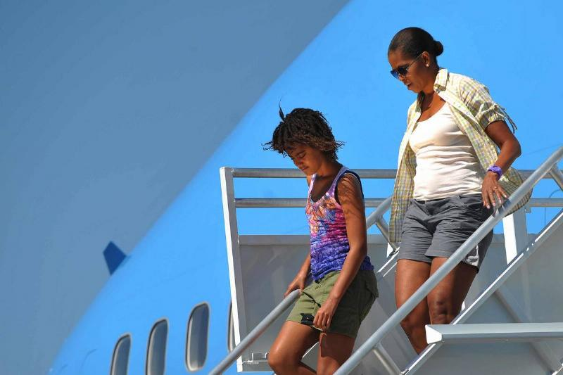 First Lady Michelle Obama and daughter Malia step off Air Force One August 16, 2009 upon arrival at Grand Canyon National Park Airport.
