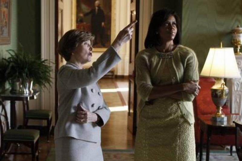 First Lady Laura Bush takes Michelle Obama for a private tour.