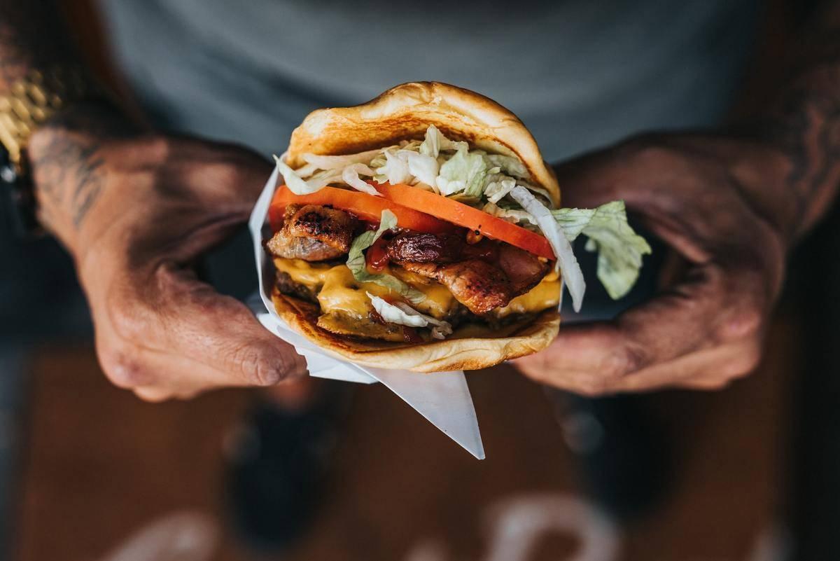 holding a hamburger