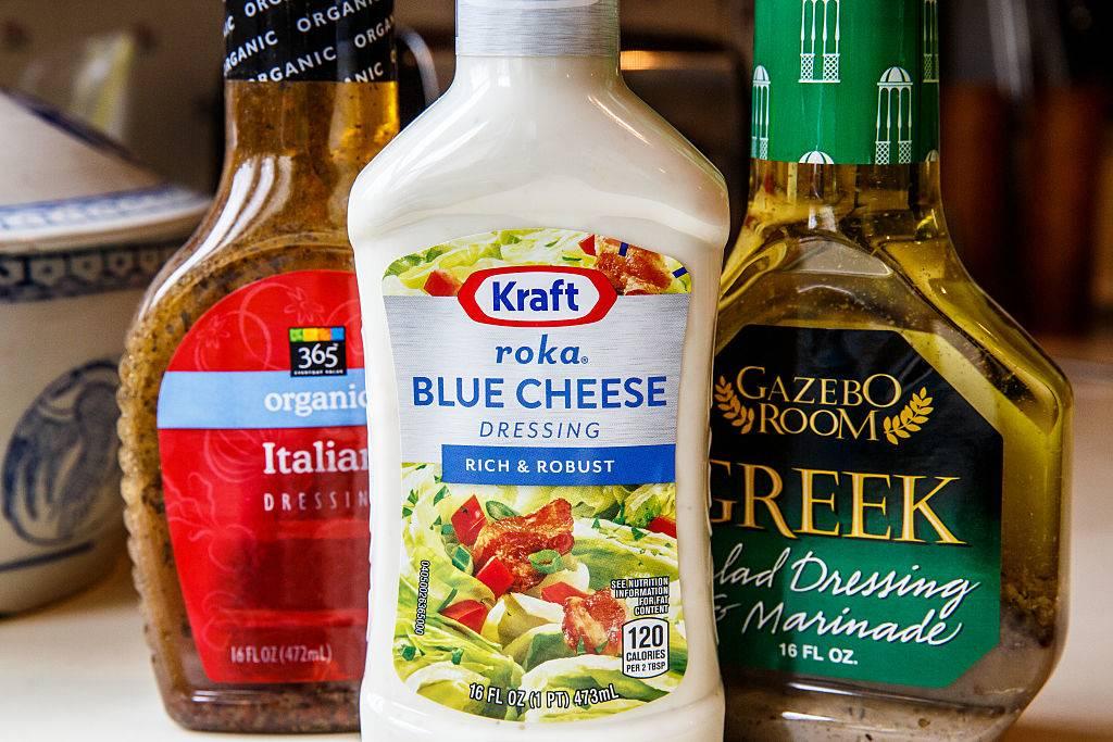 Group of prepared bottled salad dressings. Kraft Roka Blue Cheese, 365 Italian dressing and Gazebo Room Greek dressing