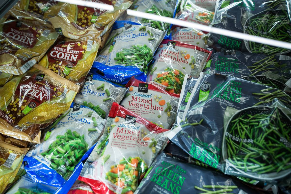 Bags of frozen vegetables are stored in an aisle at Aldi.