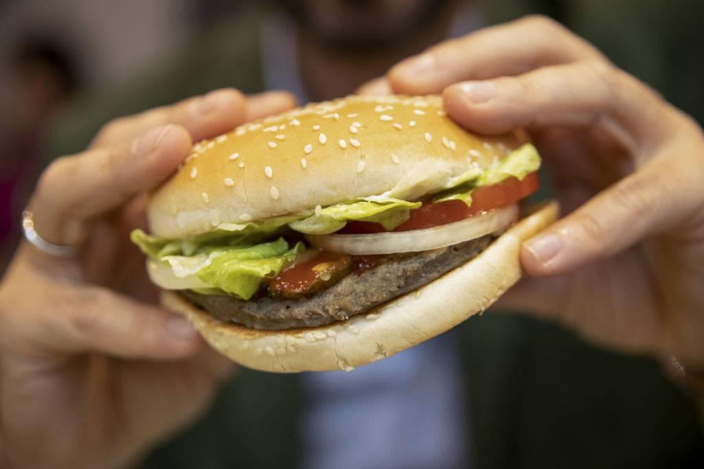 someone eating a veggie burger