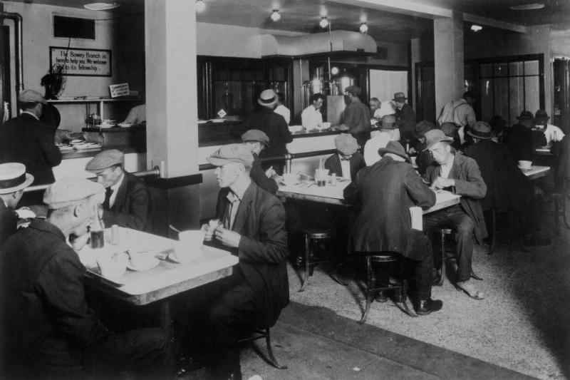Men eating in the canteen of the Bowery branch