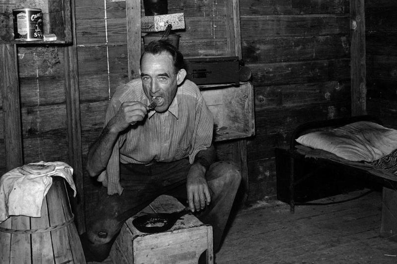 Migrant agricultural worker from Tennessee, formerly a railroad man, eating dinner in his shack