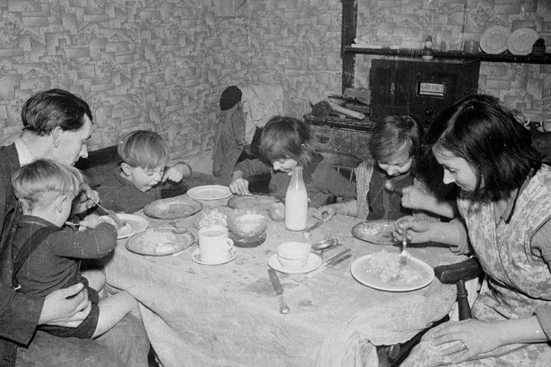 Unemployed man Alfred Smith and his family eating their main meal