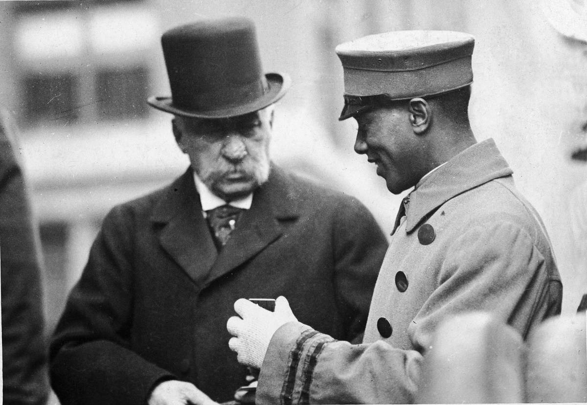 A bellboy speaks with JP Morgan in the early 1900s.