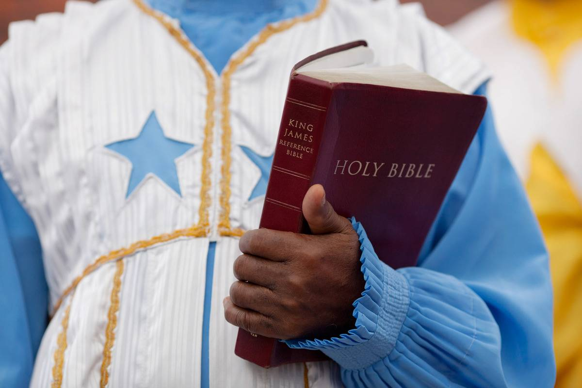 A church member carries a copy of the King James Bible.