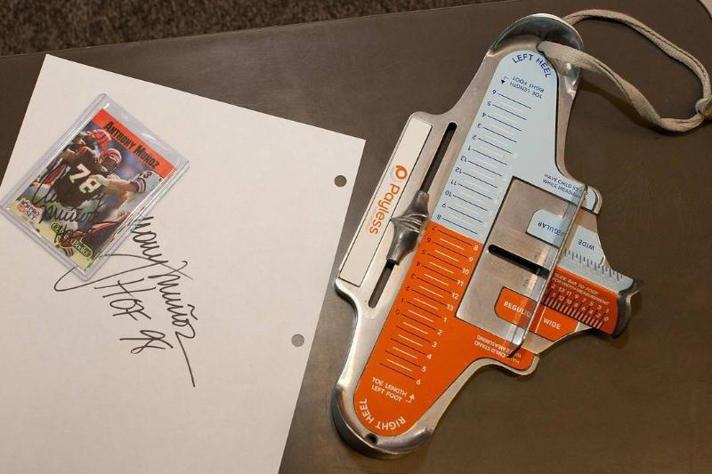 A Brannock Device is next to Autographs signed by Anthony Munoz.