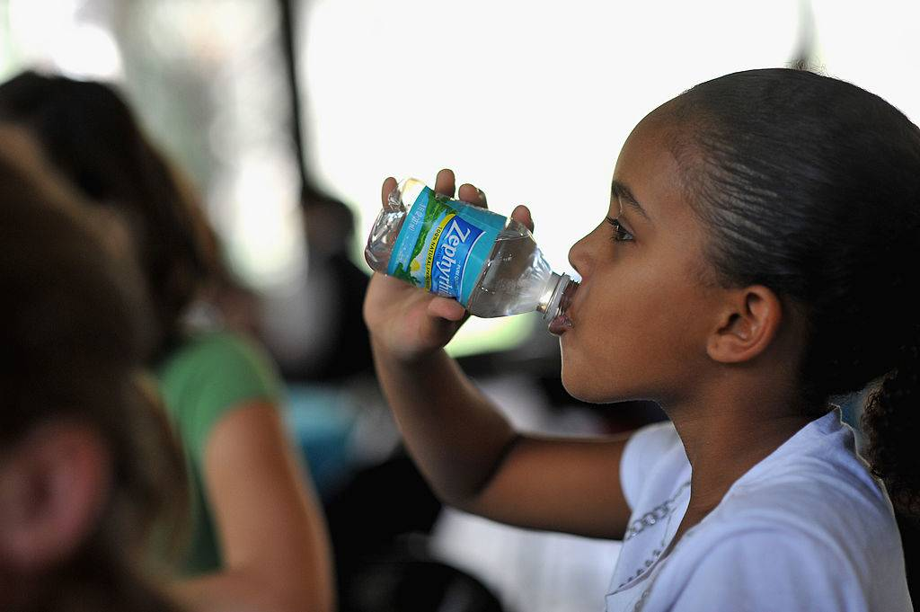 a student drinking Zephyrhills water