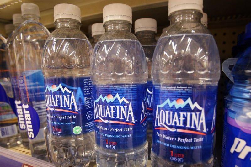 Bottle of Pepsi's Aquafina water sits on a shelf