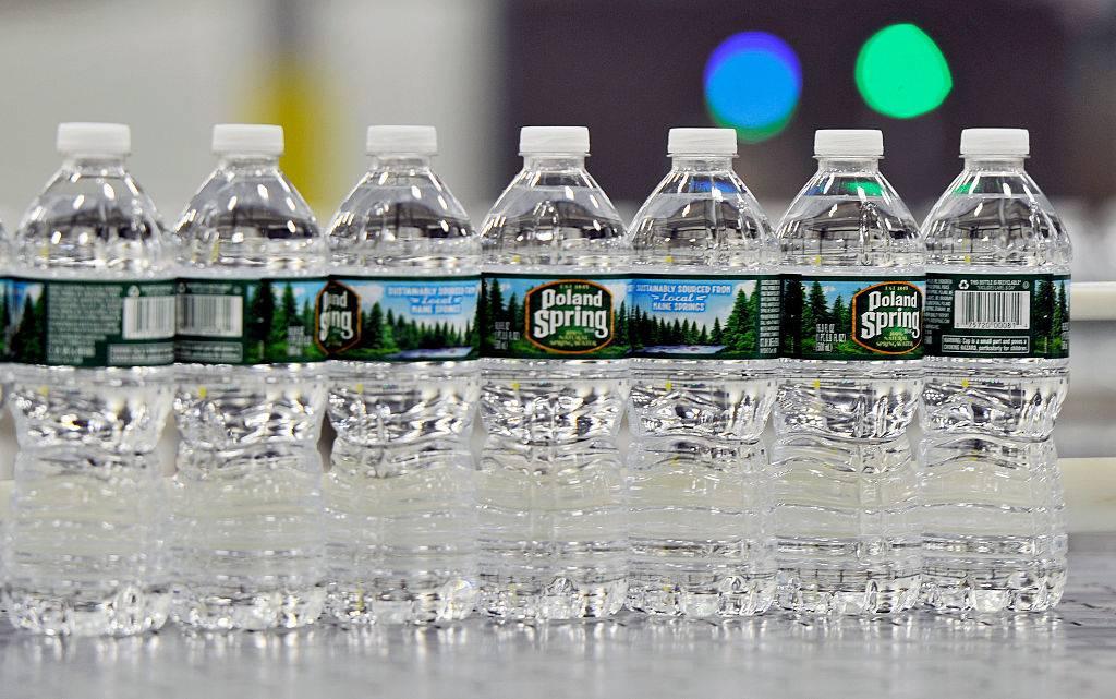 Bottles of Poland Spring water on a conveyer belt