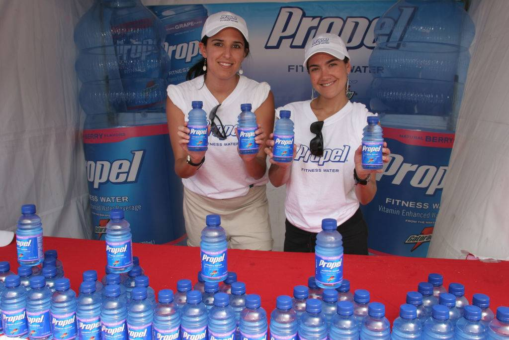 Two women handing out free Propel bottled fitness water