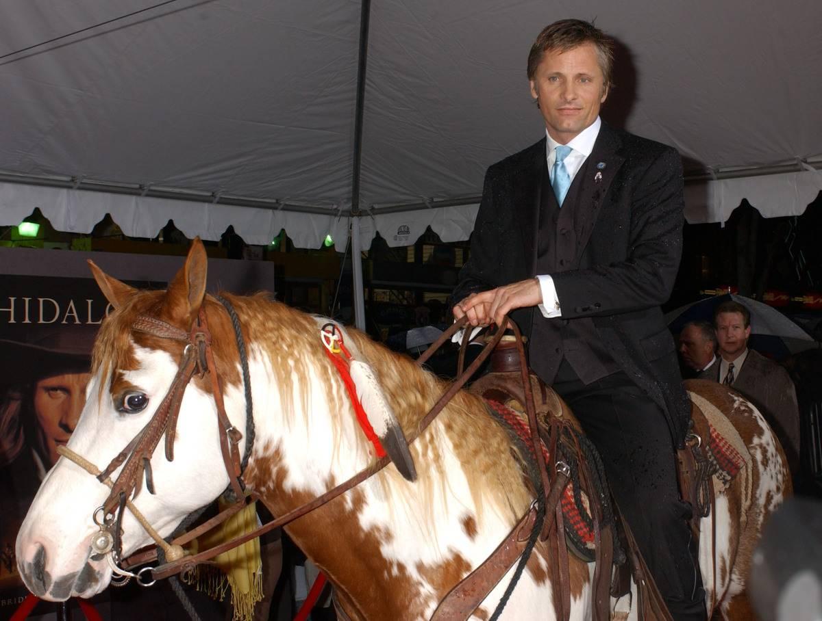 Viggo Mortensen sits atop his American Painted Horse Hidalgo to advertise the movie Hidalgo.