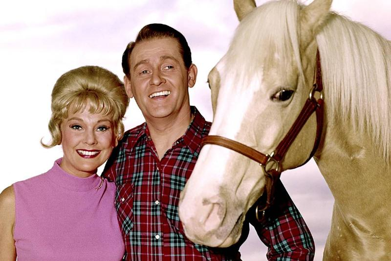 Connie Hines and Alan Young stand with Bamboo Harvester, who portrayed