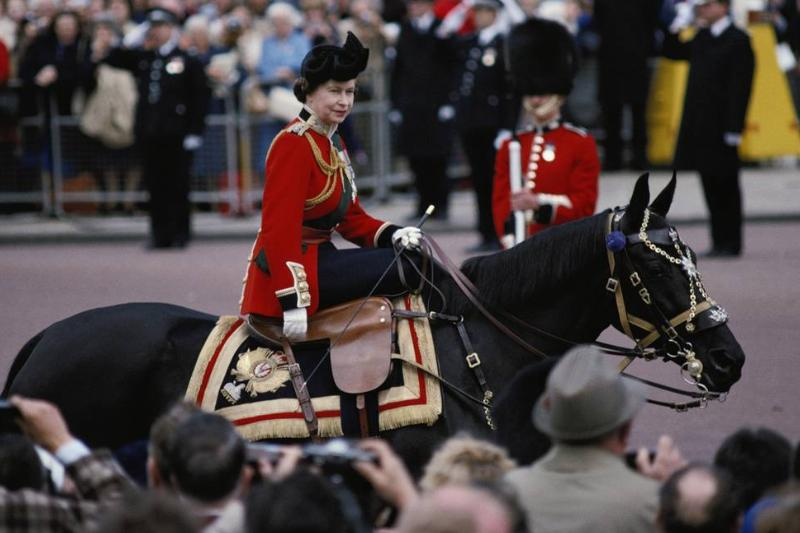 Queen Elizabeth II rides her horse, Burmase, during the Trooping the Colour ceremony.