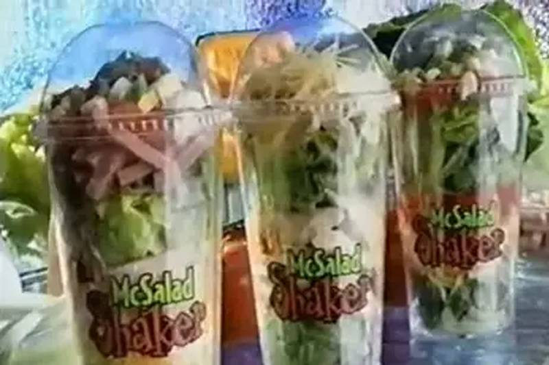 salad shakers with salad ingredients in a cup