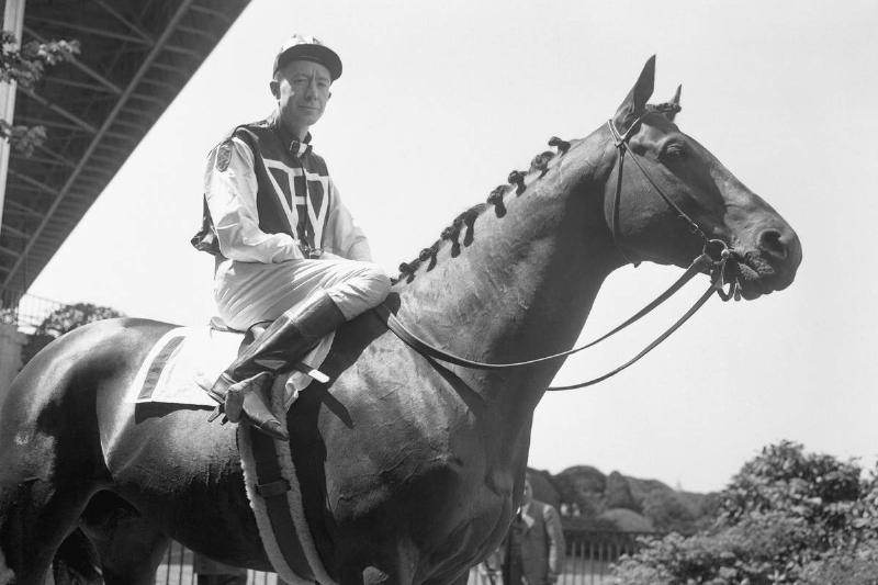 C.S. Howard sits on his horse Seabiscuit, during a race.