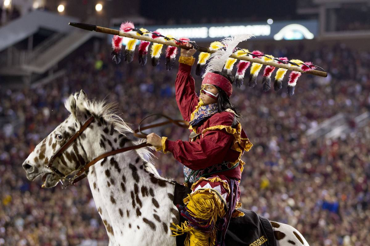 Florida State's Chief Osceola and Renegade celebrate a touchdown.